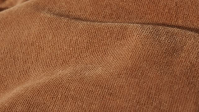 Fine texture of brown velvet textile for clothing like trousers or shirts 4K