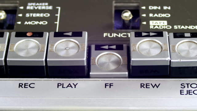 Finger Presses Forward and Rewind Control Buttons on Audio Cassette Player video