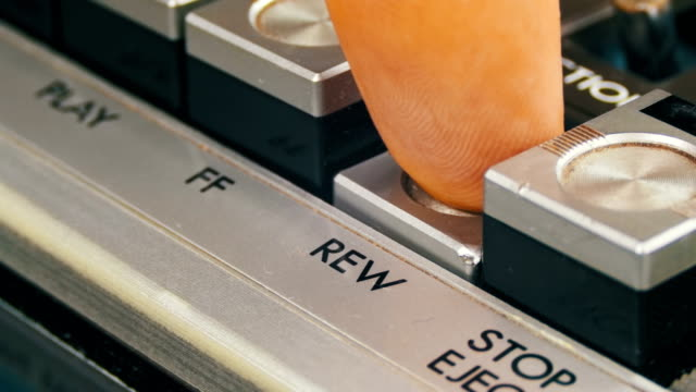 Finger Presses Rewind Control Buttons on Audio Cassette Player video