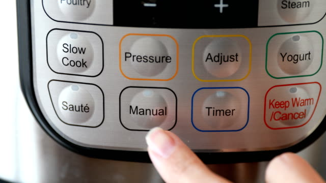 Finger Pushing Pressure Cooker Button Woman's finger pressing button on pressure cooker. cooking pan stock videos & royalty-free footage
