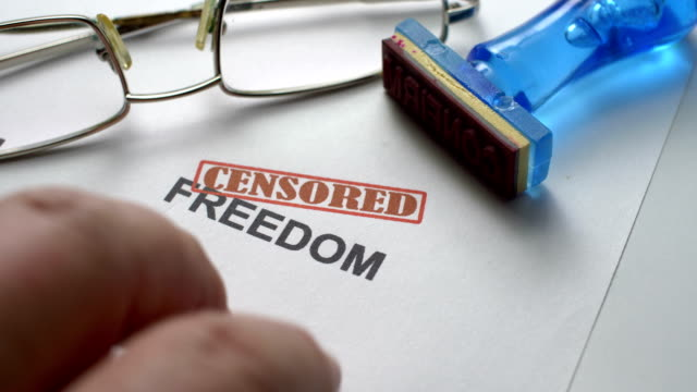 finger tapping nervous on censored freedom text - censura video stock e b–roll