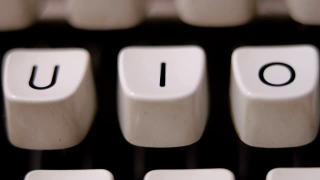 Finger typing letter I on old, retro typewriter. video