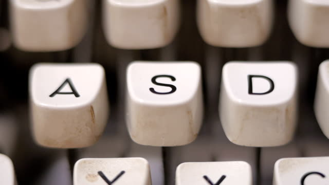 Finger typing letter S on old, retro typewriter. video