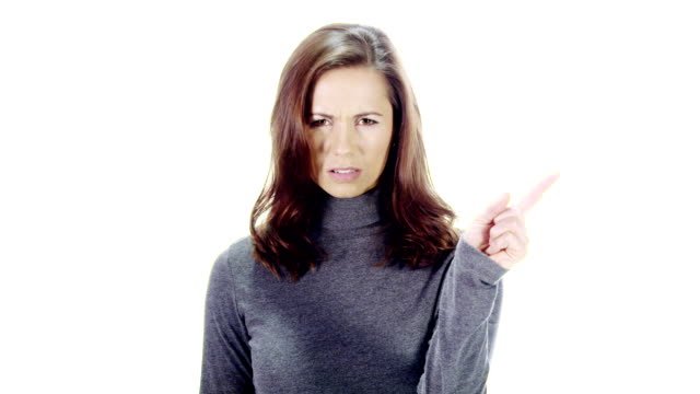 Finger wag Attractive woman unhappy and disapproving on white background middle finger stock videos & royalty-free footage