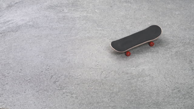 Fingerboard Rolling on Stone Ground Stop Motion Animation