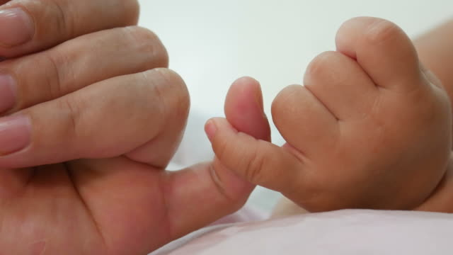 finger's mother promise baby - mothers day stock videos & royalty-free footage