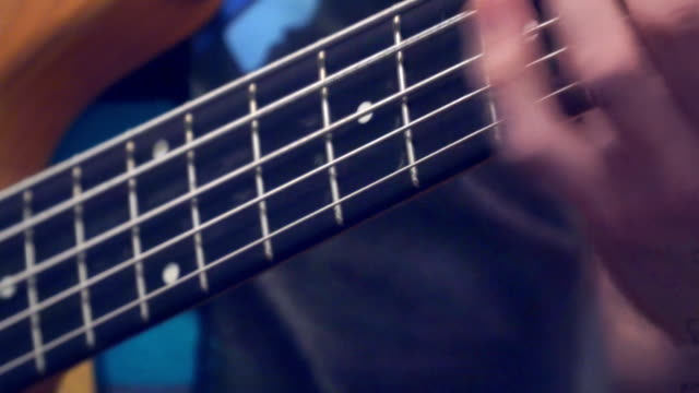 Fingers of the guitarist's bass on the fretboard video
