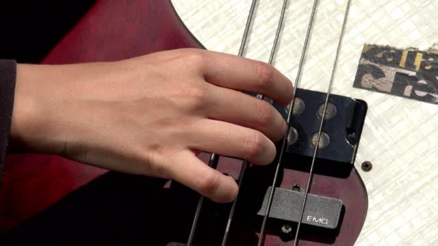 Fingers Plucking Bass Guitar Strings video