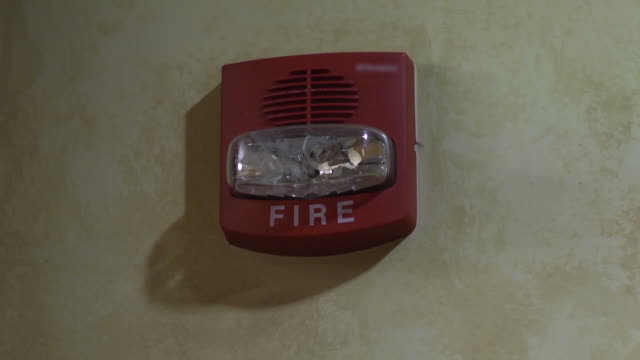 Fire Alarm with Sound Close up of wall mounted commercial fire alarm with strobe and sound. warning sign stock videos & royalty-free footage