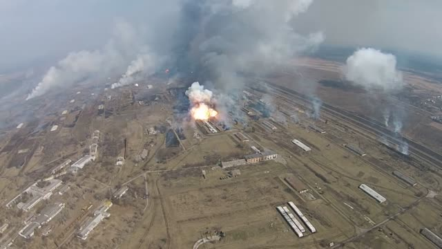 Fire at a military warehouse, explosions of shells and gunpowder, combustible materials. Fire at a military warehouse, explosions of shells and gunpowder, combustible materials. syria stock videos & royalty-free footage