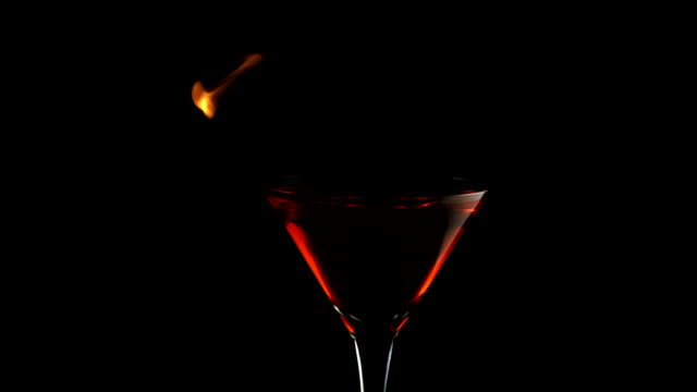 fire blowing out of martini glass, slow motion - martiniglas bildbanksvideor och videomaterial från bakom kulisserna