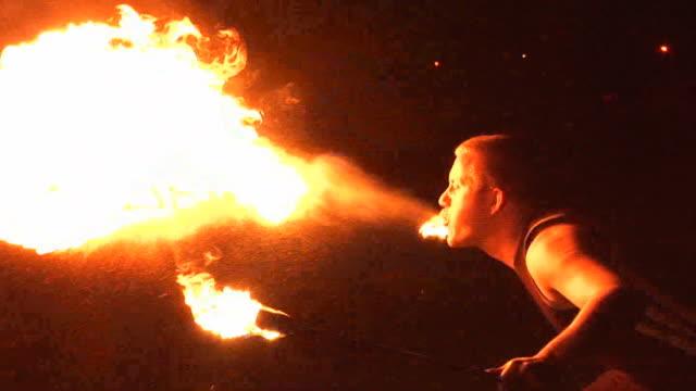 fire breather / breathing performer blow flames from mouth - circus stok videoları ve detay görüntü çekimi