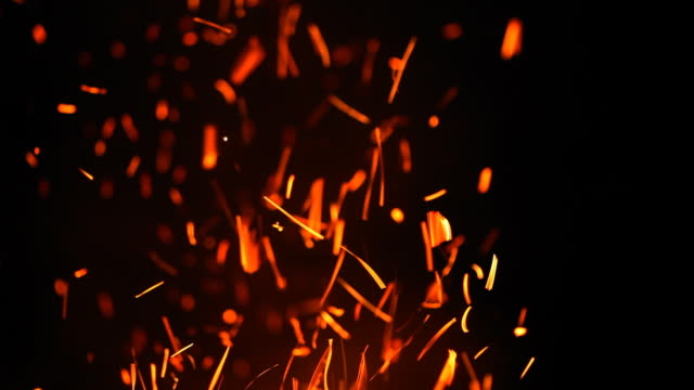 Fire burning at night with lots of sparks video