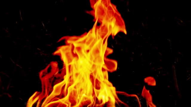 SLO MO Fire, Burning flame. Fire, Slow motion close up shot of fire flames on a black background. bonfire stock videos & royalty-free footage