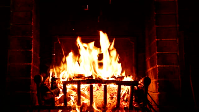 Fire burning in the fireplace hot wood burning in the fireplace heating house fireplace stock videos & royalty-free footage
