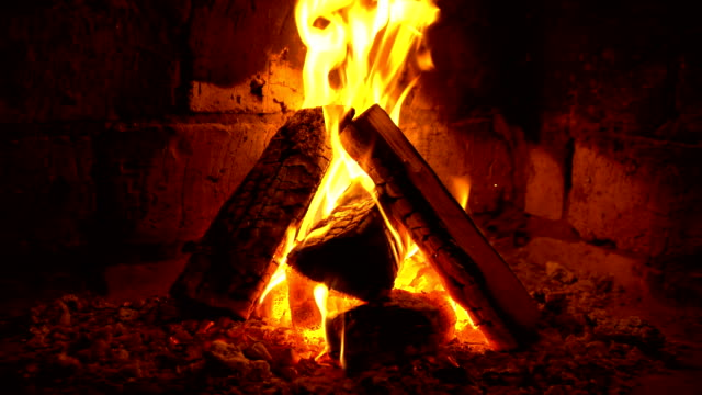 A fire burns in a fireplace, Fire to keep warm A fire burns in a fireplace, Fire to keep warm. fireplace stock videos & royalty-free footage