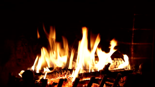 Fire burns in a fireplace Fire burns in a fireplace fireplace stock videos & royalty-free footage