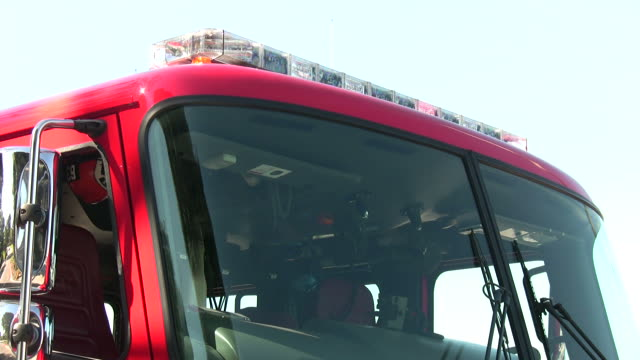(HD1080i) Fire Engine, Front Angled View with Flashing Red Lights video