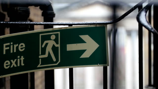A Fire Exit signage on a steel gate video