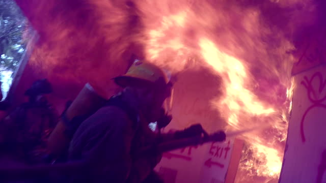 fire fighters attack interior fire - firefighter stock videos and b-roll footage