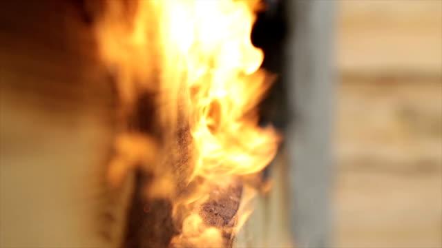 Fire flame burns a wooden surface. video