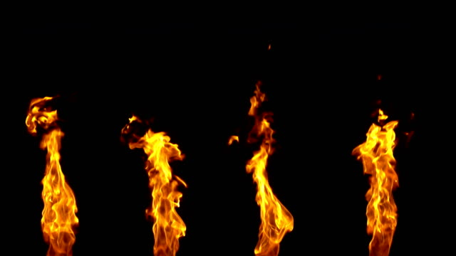 fire flame slow motion isolated on black background - fiamma video stock e b–roll