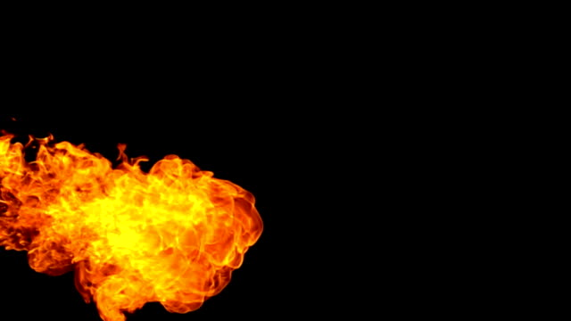 fire flamethrow on black background slow motion - fire stock videos & royalty-free footage