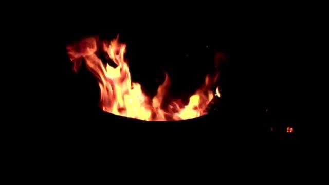 fire in a metal barrel video