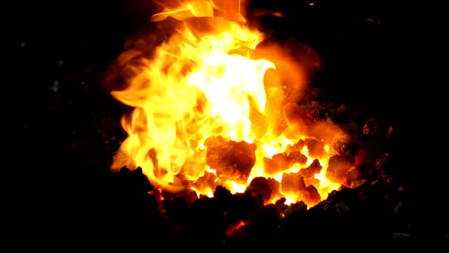 fire in a smith. orange red flames on coal fire in a smith. orange red flames on coal anvil stock videos & royalty-free footage