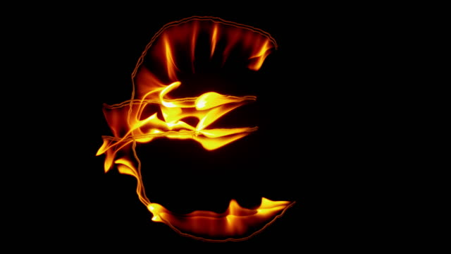 slo mo ld fire inscription of the euro symbol burning out on black background - simbolo dell'euro video stock e b–roll