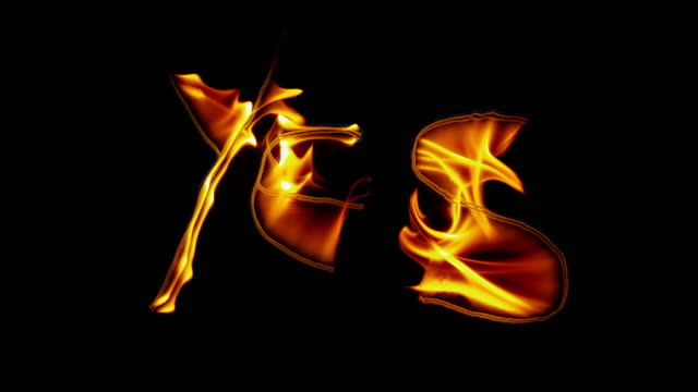 SLO MO LD Fire inscription of the word 'yes' emerging on black background