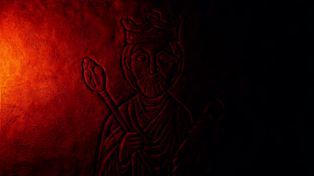 Fire Lights King Carving On Rock Wall