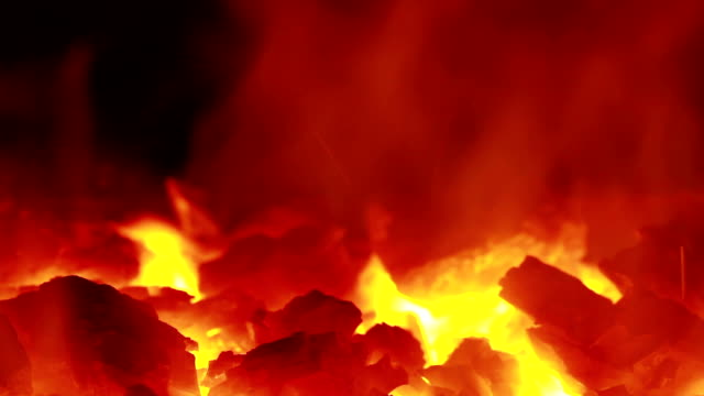 Fire of coal mine burning with sparks close up. Coal mine burning in fireplace close up Fire of coal mine burning with sparks close up. Coal mine burning in fireplace close up anvil stock videos & royalty-free footage