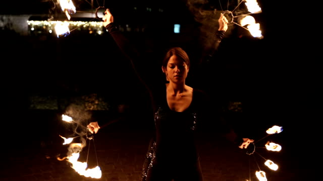 Fire show choreography,Two young woman dancing with fire Fire show choreography,Two young woman dancing with fire pyrotechnic effects stock videos & royalty-free footage