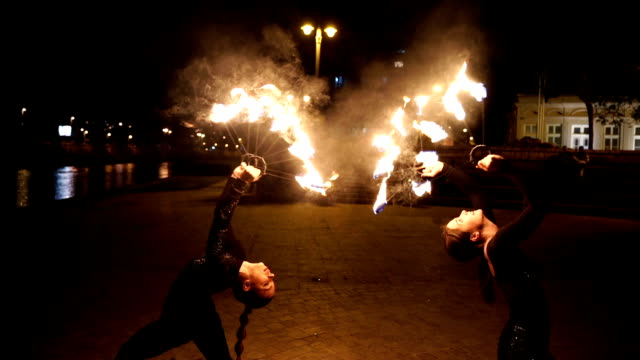 fire show, dancing with flame fire show, dancing with flame pyrotechnic effects stock videos & royalty-free footage