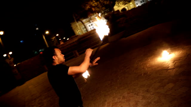 Fire show. Fire dancer at night,camera stabilization shoot,super slow motion Fire show. Fire dancer at night,camera stabilization shoot,super slow motion pyrotechnic effects stock videos & royalty-free footage