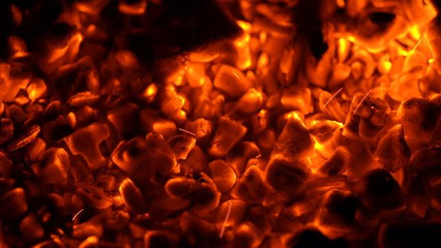 Fire sparks over hot coals (Loop 4k)