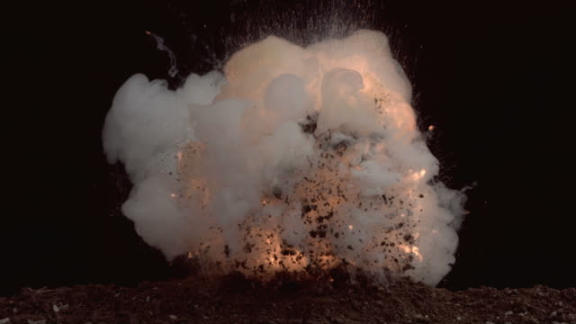 Fireball explosion in dirt, slow motion video