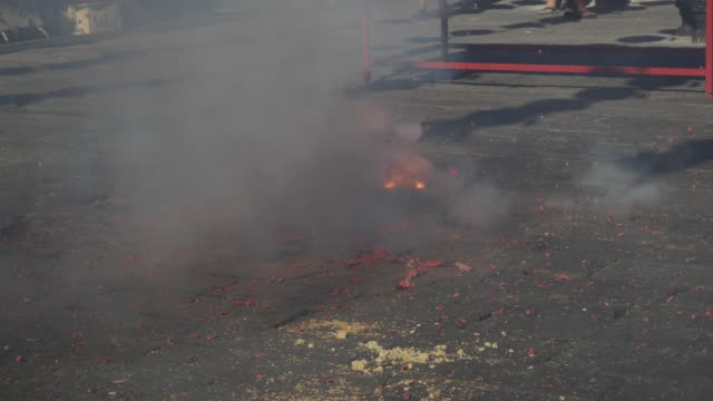 Firecrackers explode during the celebration of Chinese New Year. 4k Firecrackers explode during the celebration of Chinese New Year firework explosive material stock videos & royalty-free footage