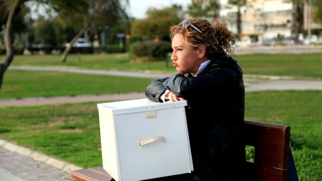 A fired businesswoman with a box of personal items video
