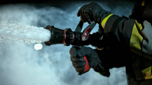 slo mo ld firefighter closing the fire hose - firefighter stock videos and b-roll footage