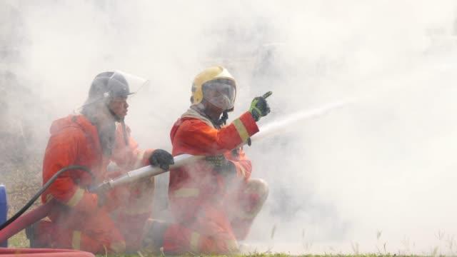 firefighter practice in smoke - gommapiuma video stock e b–roll