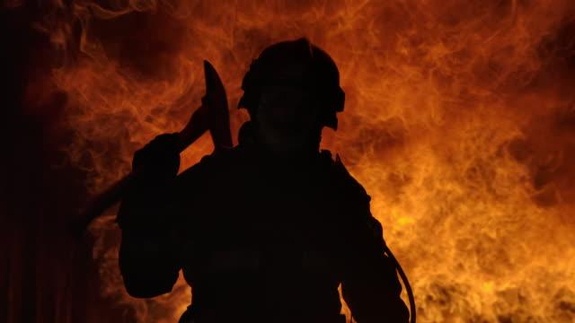 vídeos de stock e filmes b-roll de firefighter working. fire is raging. in slow motion. - super baby