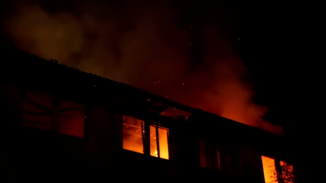 firefighters in a rescue operation - incendio doloso video stock e b–roll
