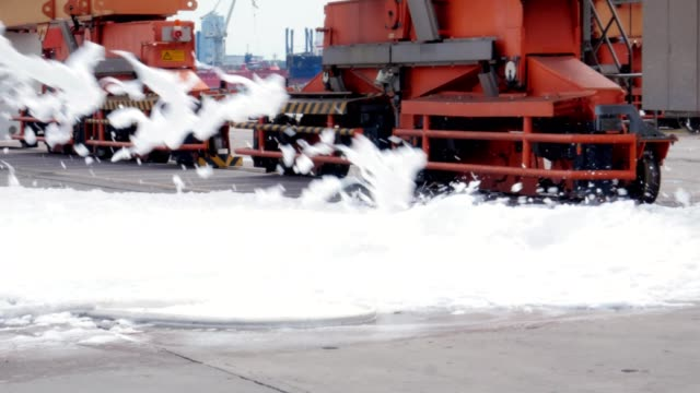 firefighters using fire-extinguishing foam - gommapiuma video stock e b–roll