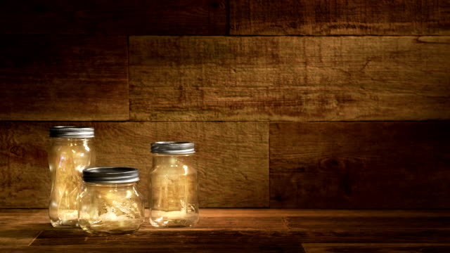 Fireflies in Jars on a Wood pallet background Video video