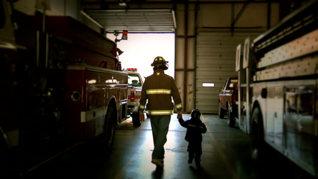 fireman and son - firefighter stock videos and b-roll footage
