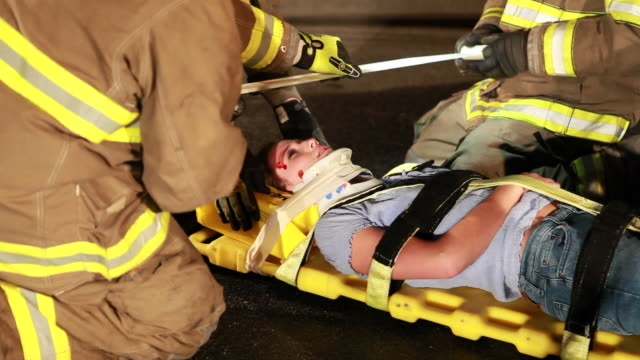 Fireman At Rescue Fireman help girl at car accident. http://i286.photobucket.com/albums/ll113/jjneff/MedicalBanner.jpg stretcher stock videos & royalty-free footage