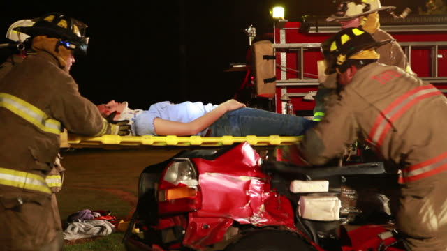 Fireman At Rescue Fireman helping victim at car accident. http://i286.photobucket.com/albums/ll113/jjneff/MedicalBanner.jpg stretcher stock videos & royalty-free footage
