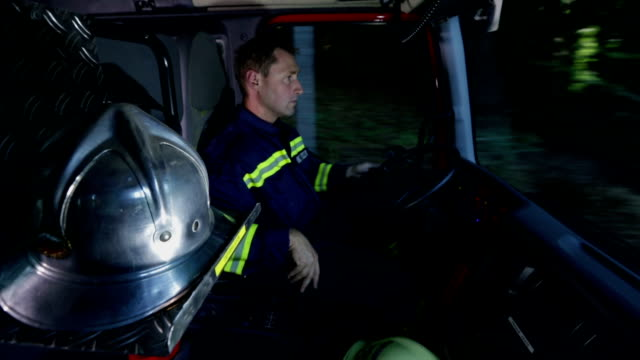 HD: Fireman driving firetruck shot in a cabin video